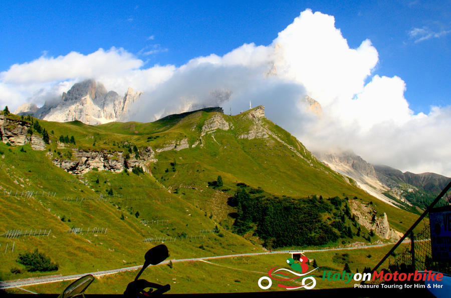 A green mountain road perfect for motorcycle tour in Italy